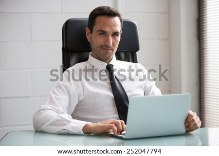 Half length portrait of a male businessman in the office