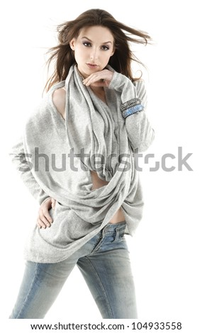 Half length portrait of beautiful slender young jeans model girl.