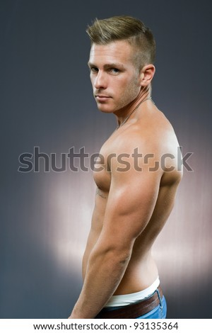 Half length portrait of fit young handsome man. - stock photo