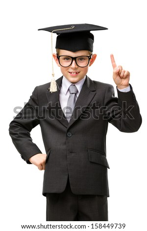 Half-length portrait of little businessman in academic cap forefinger gesturing, isolated on white. Concept of graduation and study