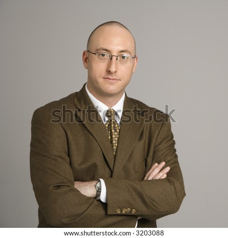 Half length portrait of mid adult Caucasian businessman.