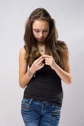Half length portrait of sad young emotional brunette.