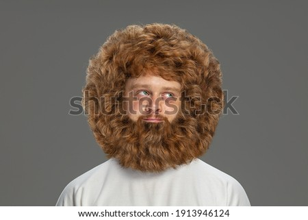Half-length portrait of young very hairy man isolated over grey background. Photo stock ©