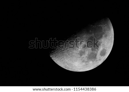 Half moon background / The Moon is an astronomical body that orbits planet Earth and is Earth's only permanent natural satellite. It is the fifth-largest natural satellite in the Solar System