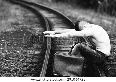 half-naked young man on a railway line black and white photography