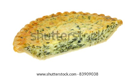 Half of a freshly baked spinach quiche pie on a white background.