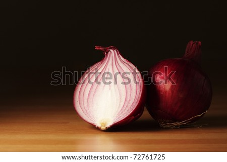 Half of a red onion and a whole red onion