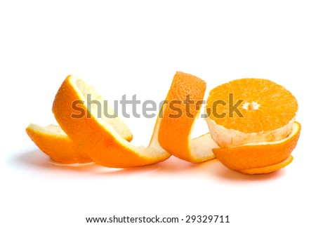 Half of an orange and some peel isolated on the white background