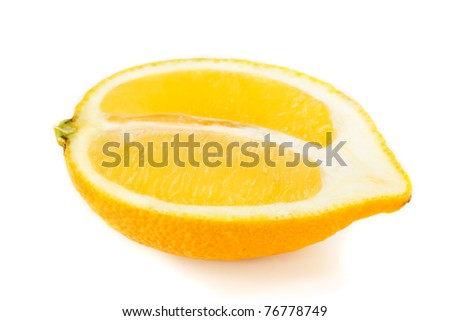 Half of fresh yellow lemon on a white background.