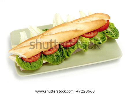 Half of long baguette sandwich - stock photo