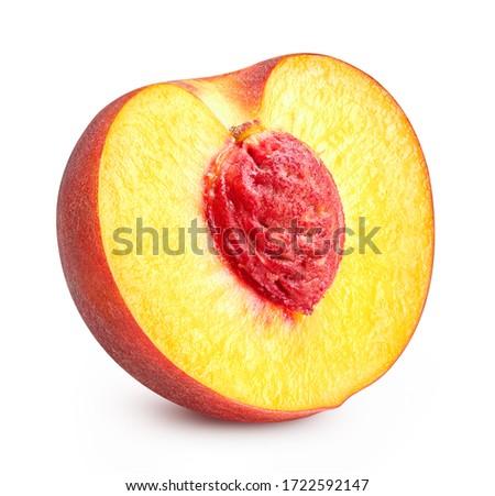 Half of peach isolated on white background. Peach fruit clipping path. Peach macro studio photo