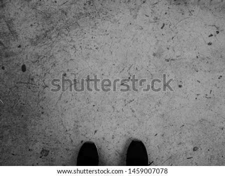 Half of Shoe on the Cement floor, black and white photography #1459007078