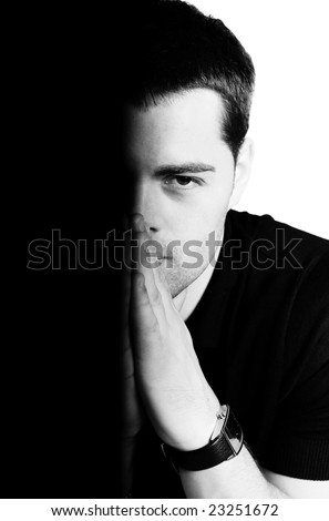 Half of young man's face isolated on white