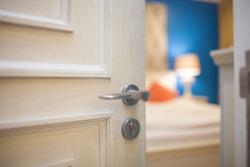 half-open door of a bedroom