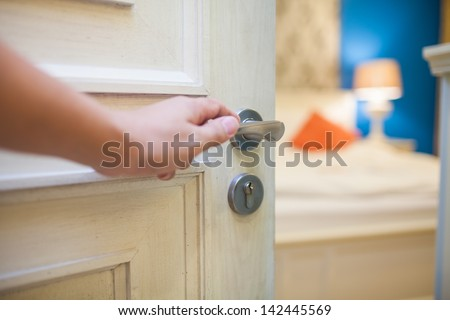 half-open door of a bedroom with hand #142445569
