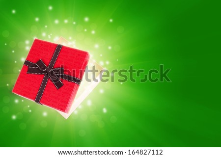 half open gift box with light inside out