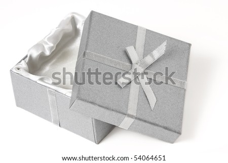 half open silver box with top leaning against the bottom; white background