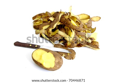 Half peeled potato, knife and potato peel isolated on the white background