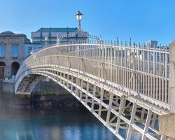 Half penny bridge, also called Ha'penny bridge,on a bridht day under blue sky in Dublin, Republic of Ireland,