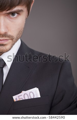 half portrait of businessman with money in the jacket