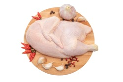 Half raw chicken, Ingredients for cooking, garlic and pepper, wooden background, isolated on white background