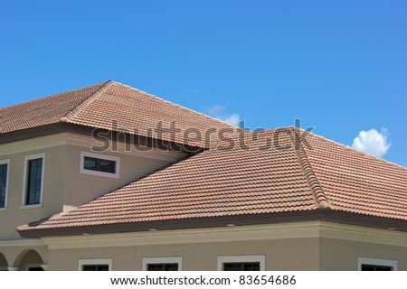 Half Round Clay Tile Roof Tops On Generic Modern Building