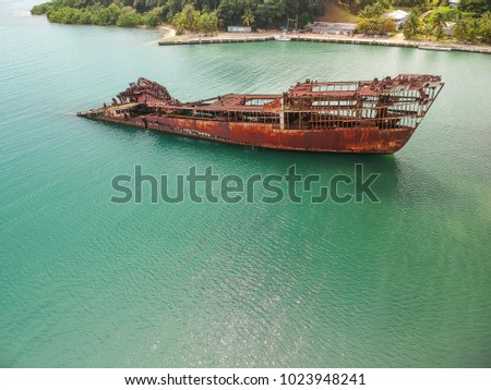Half Submerged Shipwreck In Harbor #1023948241