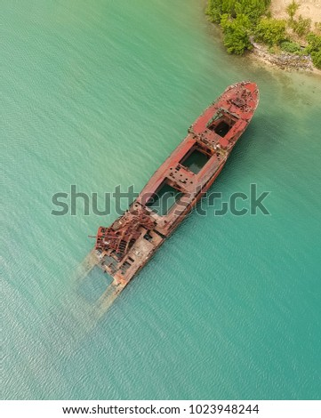 Half Submerged Shipwreck In Harbor #1023948244