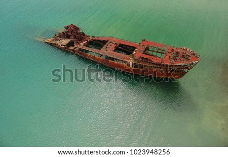Half Submerged Shipwreck In Harbor #1023948256