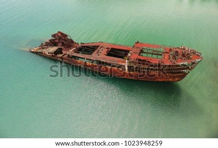 Half Submerged Shipwreck In Harbor #1023948259