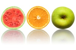 Half watermelon, half orange and green apple on white background with reflection