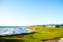 Halfmoon Bay California.  Golf course putting green and cliffs by the pacific ocean bay.  Villas and houses.