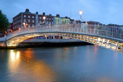 Halfpenny Bridge crossing River Liffey, Dublin, Ireland