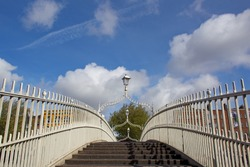 Halfpenny Bridge in Dublin, Ireland. The bridge was built in 1816 and for 100 years a halfpenny toll was charged to cross it.