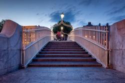 Halfpenny Bridge over River Liffey in the evening