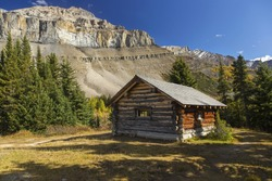 Halfway Hut, vintage landmark log cabin on great hiking trail to Skoki area of Banff National Park near Lake Louise Rocky Mountains Alberta Canada