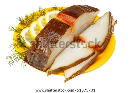 Halibut fish with lemon and dill on a yellow plate. Isolated on white background