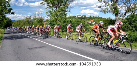 "HALIC, SLOVAKIA - JUNE 7: Cyclists compete in the ""Tour de Slovaquie 2012"" on June 7, 2012 in Halic, Slovakia"