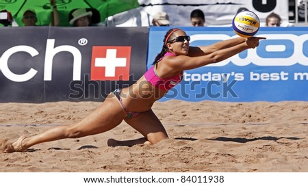 HALIFAX, CANADA - SEPTEMBER 3: Canada's Victoria Altomare reaches for the ball at the FIVB Beach Volleyball Swatch Junior World Championships on Sept. 3, 2011 in Halifax, Canada.