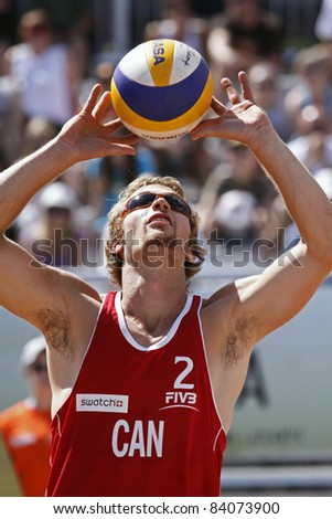 HALIFAX, CANADA - SEPTEMBER 2: William Sidgwick of Canada passes the ball at the FIVB Beach Volleyball Swatch Junior World Championships on Sept. 2, 2011 in Halifax, Canada.
