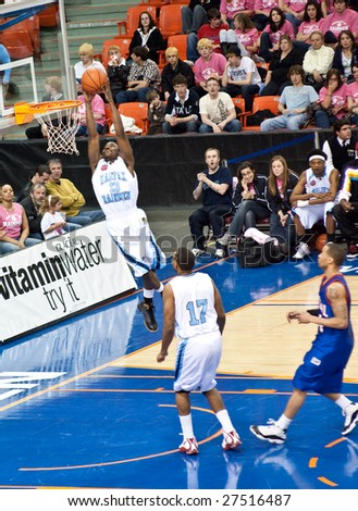 HALIFAX- MARCH 28: A Halifax Rainmen player slam dunks at Premier Basketball League at the Halifax Metro Centre March 28, 2009 in Halifax, NS. The Halifax Rainmen beat the Montreal Sasquatch 130-89.
