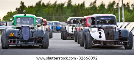 HALIFAX, NOVA SCOTIA - JUNE 19: Race cars in formation prior to Maritime League of Legends racing action at Scotia Speedworld, in Halifax, Nova Scotia onJune 19, 2009.