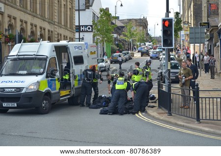 HALIFAX, WEST YORKSHIRE, ENGLAND-JUL 10: Riot Police prepair to control demonstrators of the EDL (English Defence League) organised rally on July 10, 2010 in Halifax, West Yorkshire