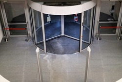 Hall and entrance of modern office building with revolving door, top view