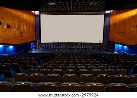 Hall of a cinema and lines of blue armchairs