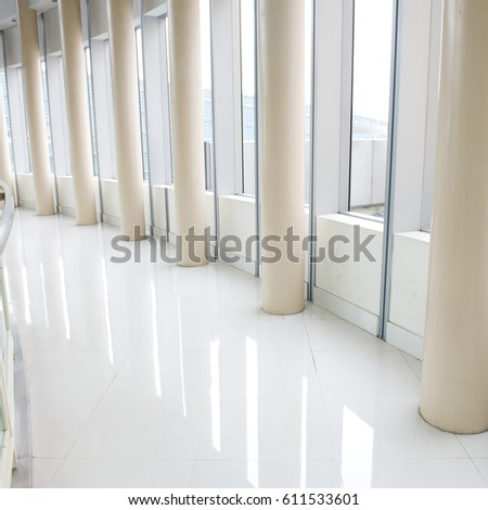 Hall of business building with light from window  #611533601