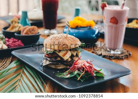 Halloumi cheese vegetarian burger served with salad