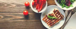 Halloumi grilled cheese with grilled bell peppers, tomatoe and arugula. Top view, Banner for website header design with copy space for text