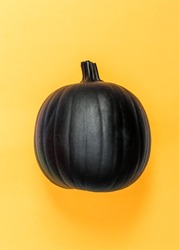 Halloweeen theme with a black pumpkin on a yellow background