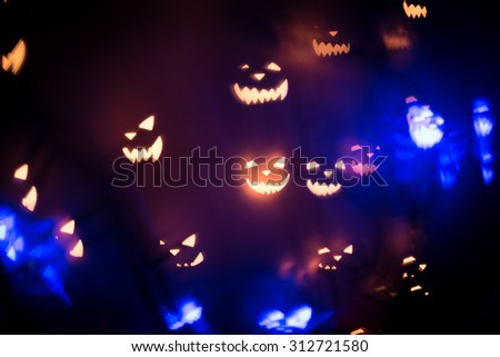 Halloween abstract glowing blurred background. Close up bokeh. Defocused blinking shaped lights. Halloween Background. Holiday backdrop